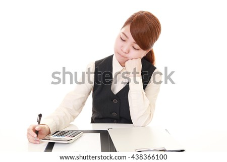 Tired and stressed Asian business woman  - stock photo