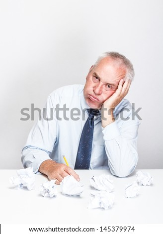 Tired and stressed businessman in office - stock photo