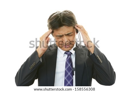 Tired and stressed customer services operator - stock photo