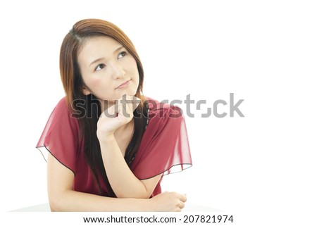 Tired and stressed young Asian woman