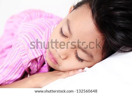 Tired asian girl sleeping soundly. - stock photo