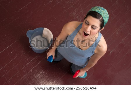 Tired Blue Collar Worker Maid Doing Cleaning Chores Scrubbing Floor