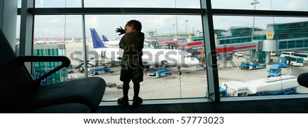 tired boy on airport window background