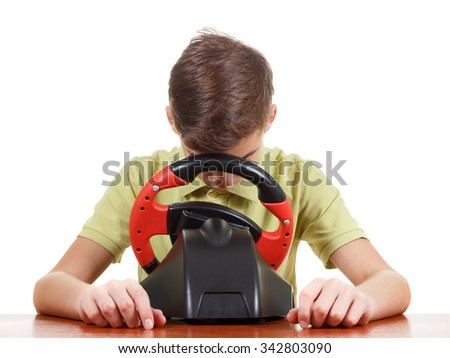 Tired Boy plays a driving game console, isolated on white
