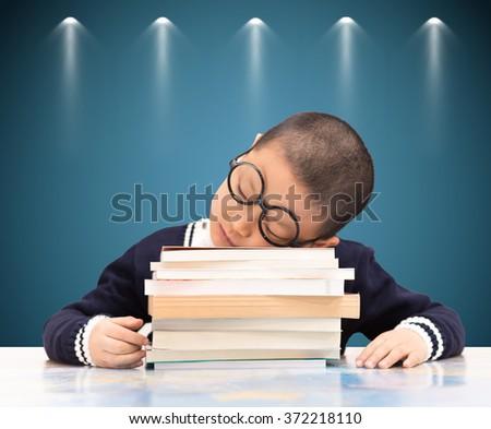 Tired Boy Sleeping on the School Desk - stock photo