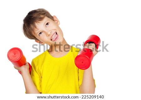 Tired boy with red dumbbell - stock photo