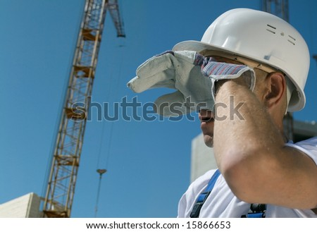 Tired builder on blue sky background