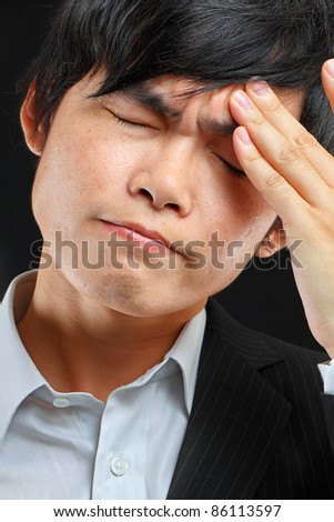 Tired business man holding his head - stock photo