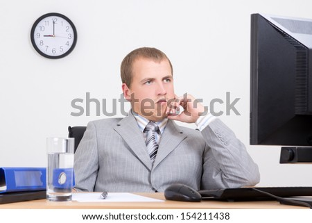 tired business man sitting at workplace - stock photo