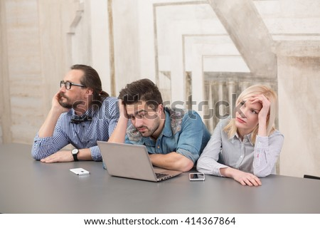 Tired business people working in office. Exhausted workers resting after hard working day - stock photo