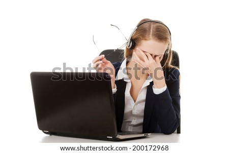 Tired business woman at call center sitting by the table or it is a failure. Isolated on white. - stock photo