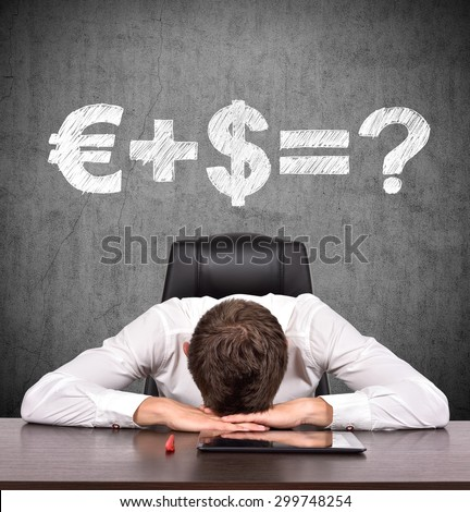 tired businessman and drawing money formula on wall - stock photo