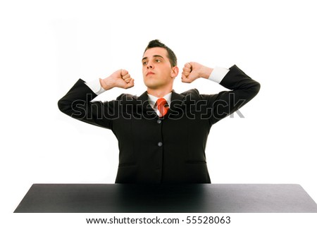 Tired businessman at his desk in the office, on white background