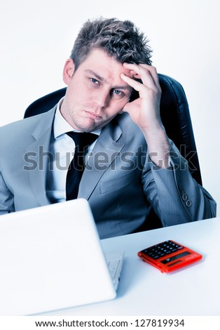 tired businessman at the office - stock photo