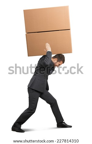 tired businessman in the suit carrying two heavy boxes. isolated on white background - stock photo