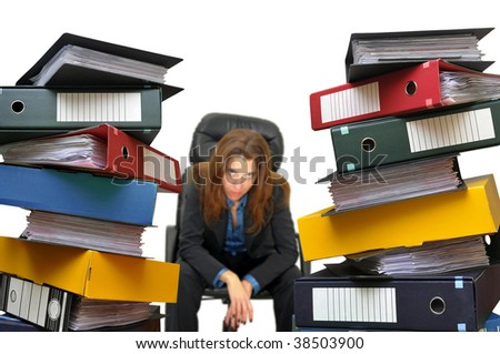 Tired businesswoman looking at a file chaos isolated in white