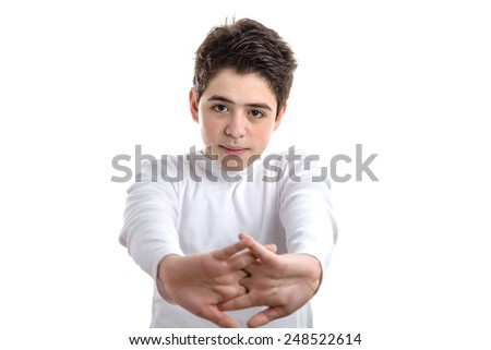Tired Caucasian smooth-skinned boy in a white long sleeve t-shirt stretching his back with clasped hands - stock photo