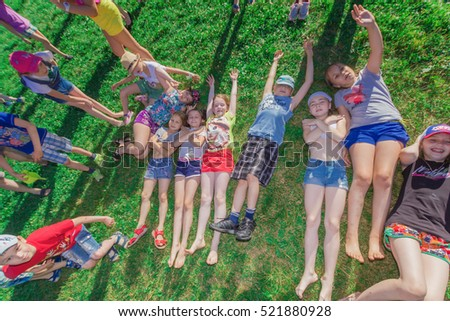 "Tired children lying on the grass.Children's camp ""Berezka"".Editorial. Russia. Yaroslavl region  28.06.2016"