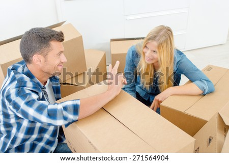 Tired couple are moving house - stock photo