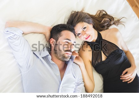 Tired Couple Lying on Bed - stock photo