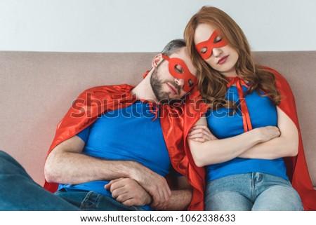 tired couple superheroes masks cloaks sleeping stock photo royalty