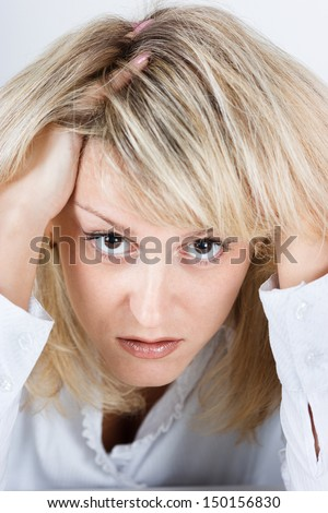 Tired disheveled distraught girl looking at the camera - stock photo