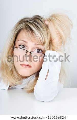 Tired disheveled unhappy girl looks into the camera - stock photo