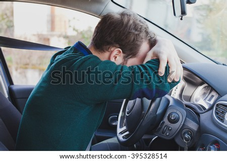 tired driver in the car - stock photo