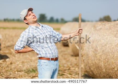 Tired farmer with backache