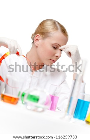 Tired female doctor puts the glasses off, isolated on white