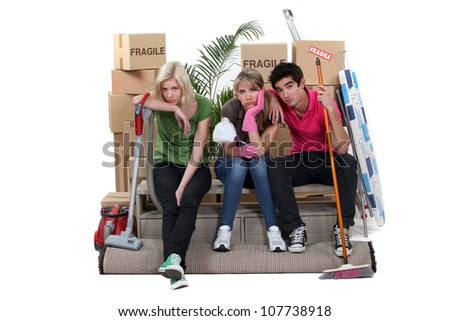 Tired friends on moving day - stock photo