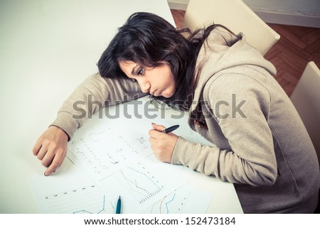 Tired Girl Studying at Home - stock photo