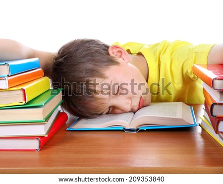 Tired Kid Sleeping on the School Desk on the white background - stock photo