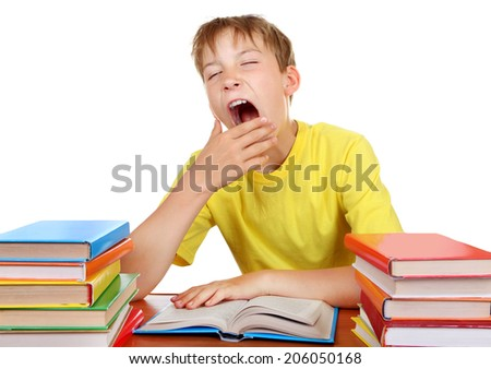 Tired Kid Yawning at the School Desk with a Books on the white background - stock photo
