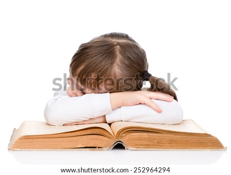 tired little girl  sleeping on the book. isolated on white background
