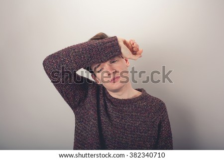 Tired man - stock photo