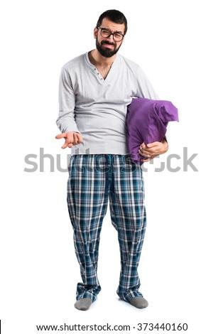 Tired man in pajamas - stock photo