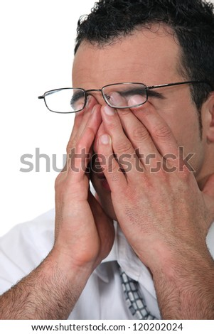 Tired man wearing glasses - stock photo