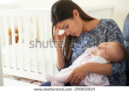 Tired Mother Suffering From Post Natal Depression - stock photo