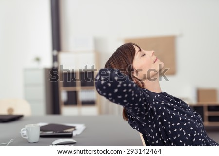 Tired Office Woman at her Worktable, Leaning her Back on a Chair with Hands at the Back of her Head and Eyes Closed, Emphasizing of Thinking Something.