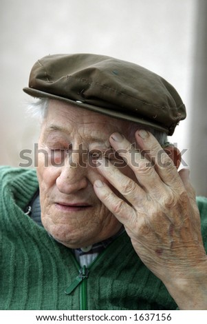Tired old man - stock photo