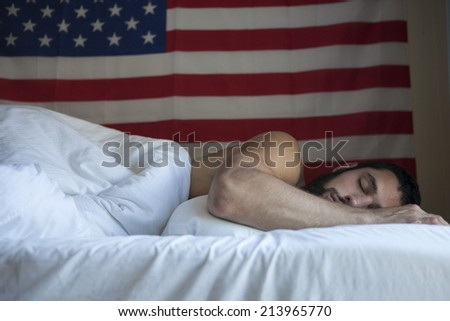 Tired olympian taking a nap after a long day of training - stock photo