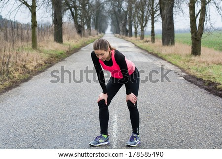 Tired Runner girl - stock photo