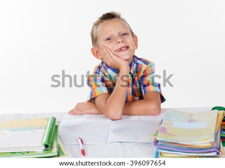 Tired school boy smiling without milk tooth  - stock photo