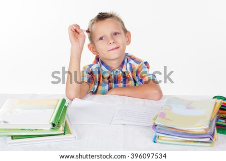 Tired school boy thinking task - stock photo