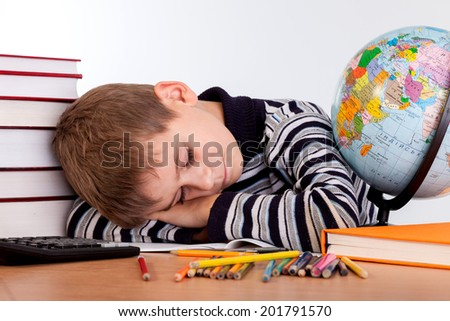 Tired schoolboy isolated on a white background - stock photo