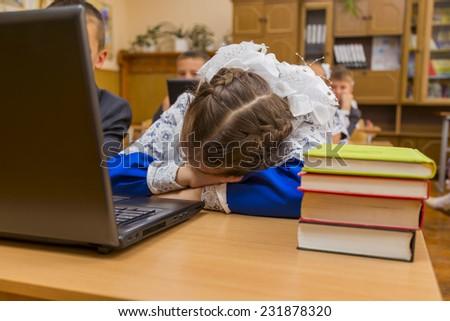 tired schoolgirl sleeping in class - stock photo