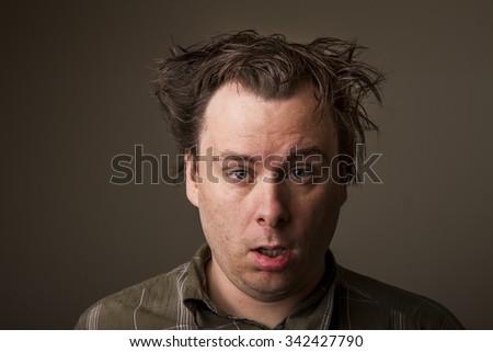 Tired shabby, man waiting to go back to sleep - stock photo
