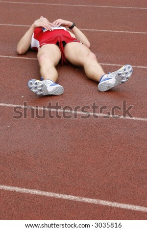 tired sportsman after a race - stock photo