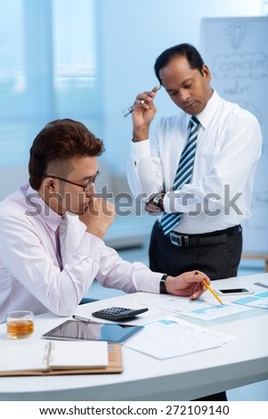 Tired stressed business people working with papers